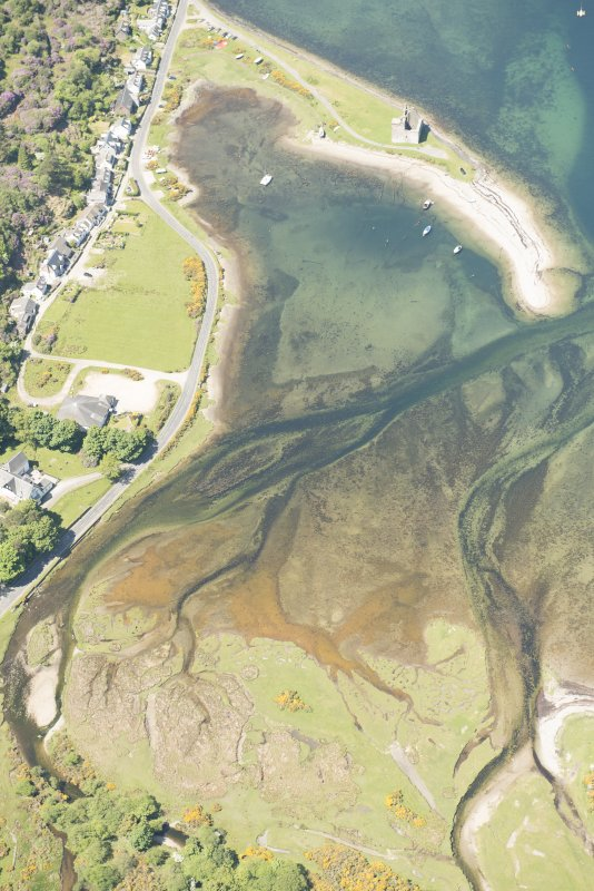 Oblique aerial view of Lochranza Fish Trap and Lochranza Castle, looking to the NW.