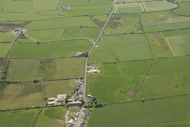 General oblique aerial view of St Molio's Church, looking to the NNE.