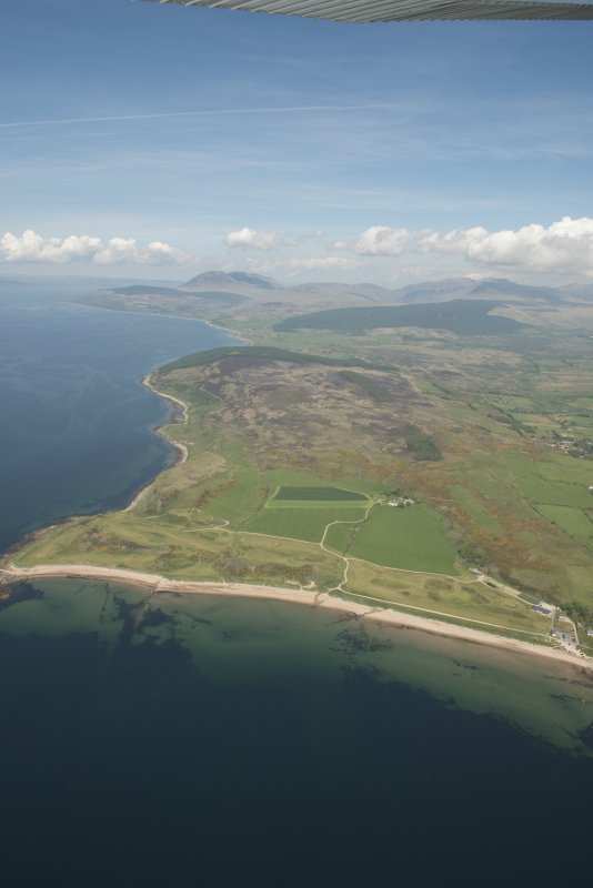 General oblique aerial view of the west coast of Arran with Shiskine Golf Course in the foreground, looking to the NNE.