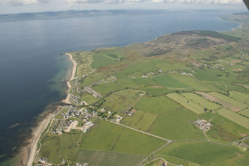 General oblique aerial view of the south west coast of Arran with Shiskine in the foreground, looking to the NW.