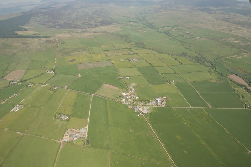 General oblique aerial view of the field systems around the village of Sliddery, looking to the NE.