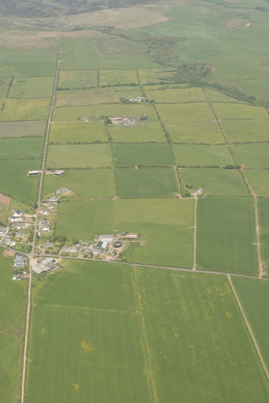 General oblique aerial view of the field systems around the village of Sliddery, looking to the N.