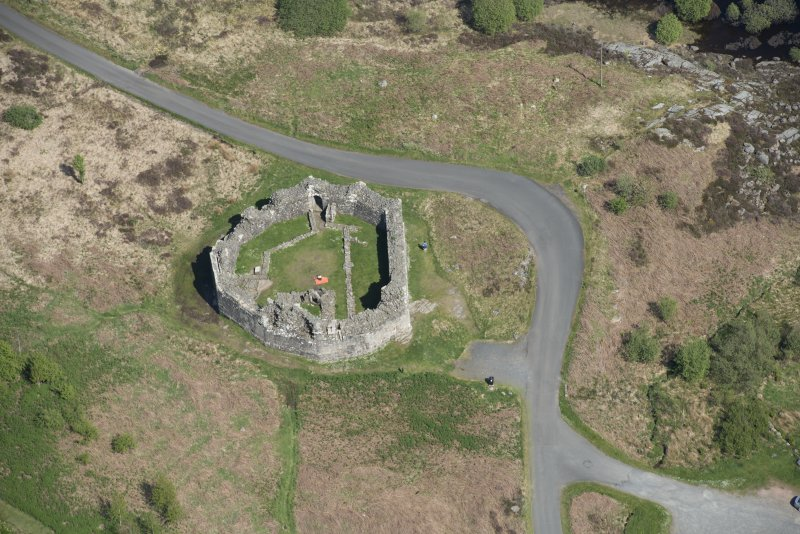 Oblique aerial view of the re-erected site of Loch Doon Castle, looking to the E.