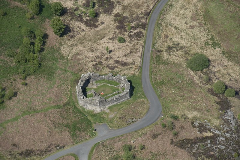 Oblique aerial view of the re-erected site of Loch Doon Castle, looking to the NNE.