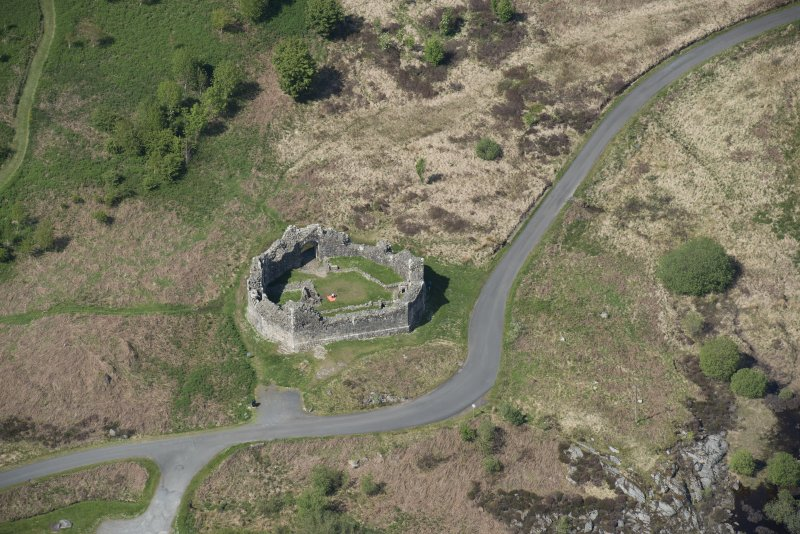 Oblique aerial view of the re-erected site of Loch Doon Castle, looking to the N.