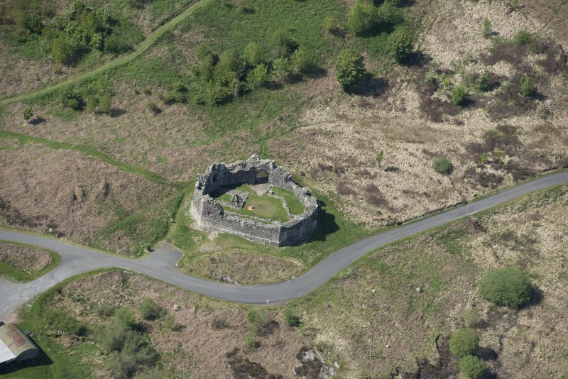 Oblique aerial view of the re-erected site of Loch Doon Castle, looking to the NW.