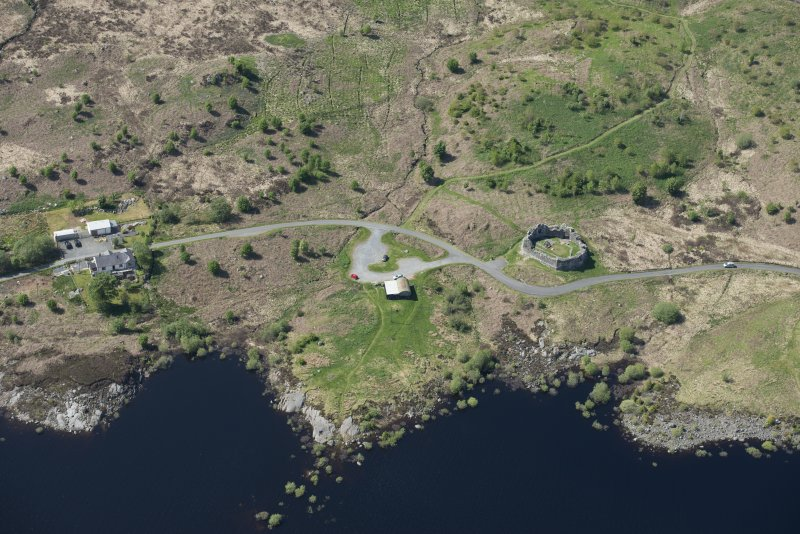 Oblique aerial view of the re-erected site of Loch Doon Castle, looking to the NNW.