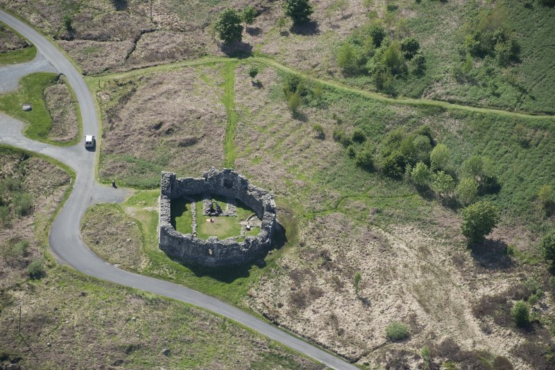 Oblique aerial view of the re-erected site of Loch Doon Castle, looking to the W.