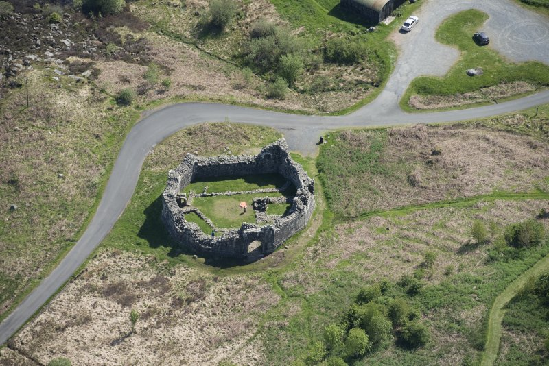 Oblique aerial view of the re-erected site of Loch Doon Castle, looking to the S.
