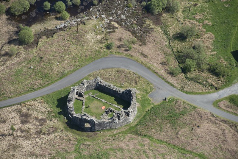 Oblique aerial view of the re-erected site of Loch Doon Castle, looking to the SW.