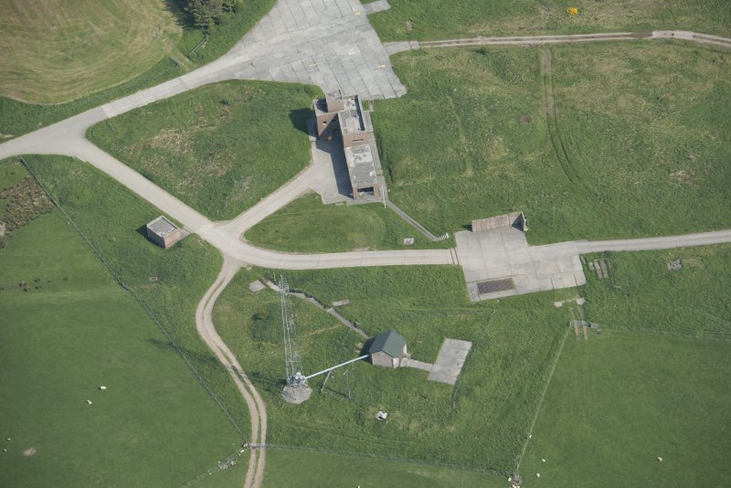 Oblique aerial view of the firing position and buildings on Brown Hill (NX7358 4664), looking ESE.