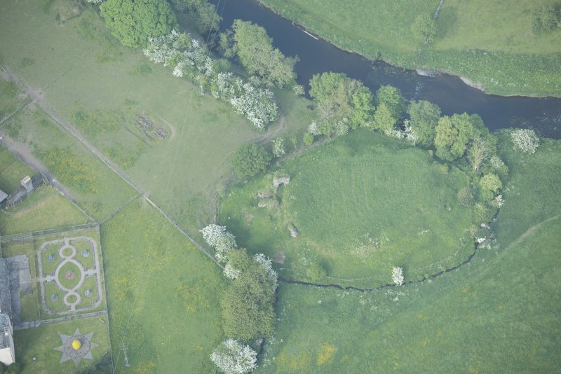 Oblique aerial view of Buittle Castle, looking to the NNE.
