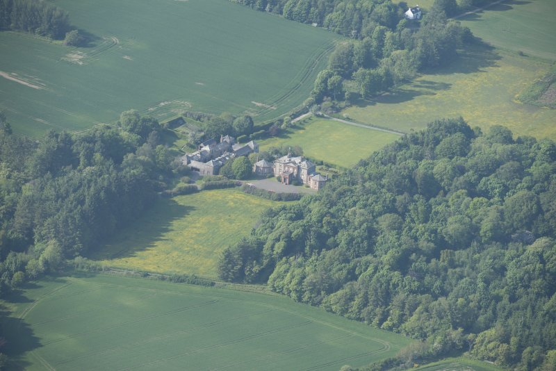 Oblique aerial view of Arbigland House and stable block, looking to the NNW.