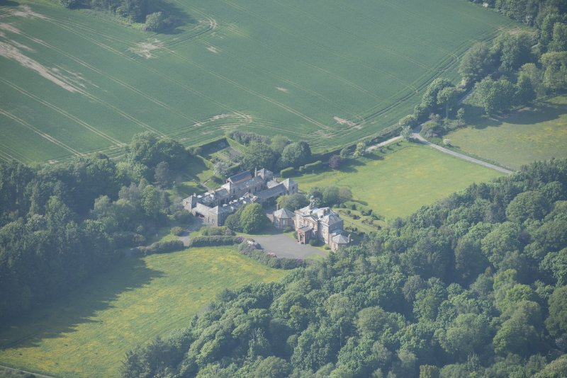 Oblique aerial view of Arbigland House and stable block, looking to the N.