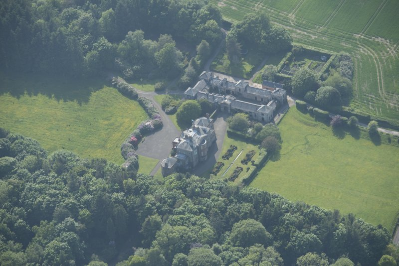Oblique aerial view of Arbigland House and stable block, looking to the W.