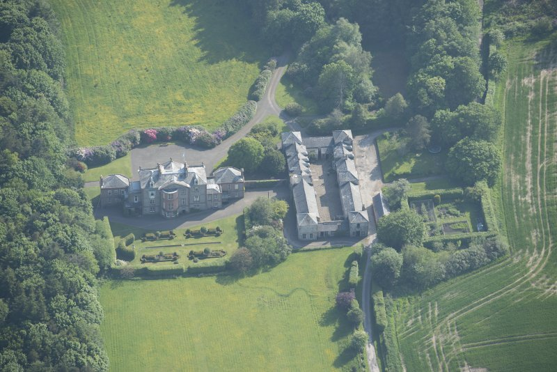 Oblique aerial view of Arbigland House and stable block, looking to the SW.