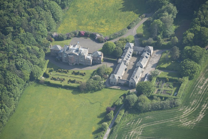 Oblique aerial view of Arbigland House and stable block, looking to the S.