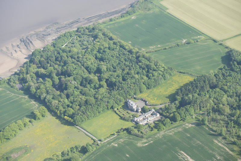 Oblique aerial view of Arbigland House, stable block and walled garden, looking to the SSE.