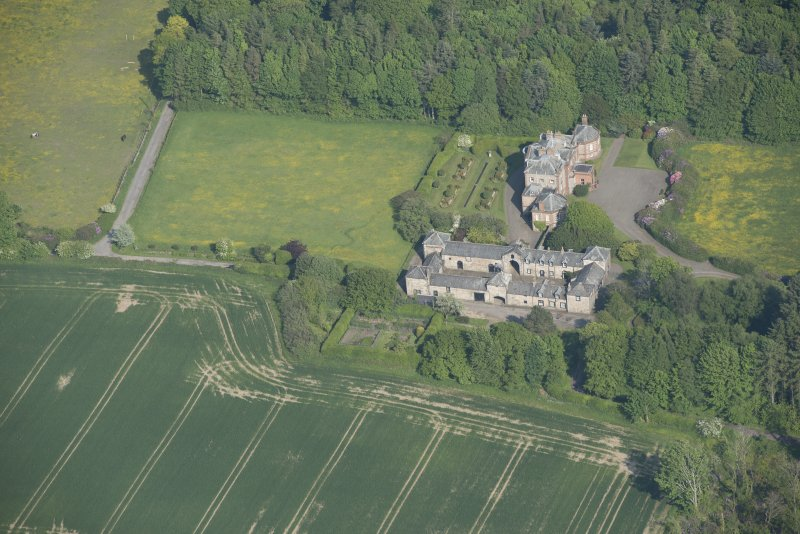 Oblique aerial view of Arbigland House and stable block, looking to the ESE.