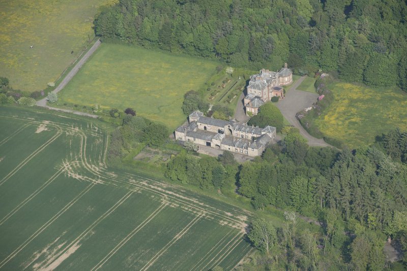 Oblique aerial view of Arbigland House and stable block, looking to the E.