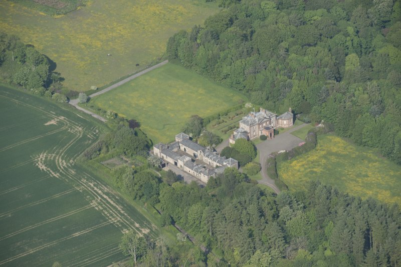 Oblique aerial view of Arbigland House and stable block, looking to the ENE.