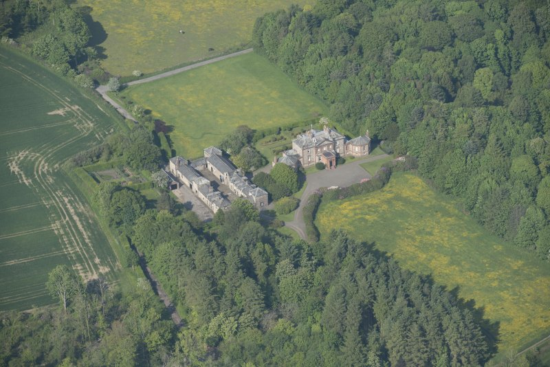 Oblique aerial view of Arbigland House and stable block, looking to the NE.