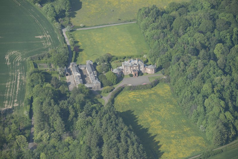 Oblique aerial view of Arbigland House and stable block, looking to the NNE.