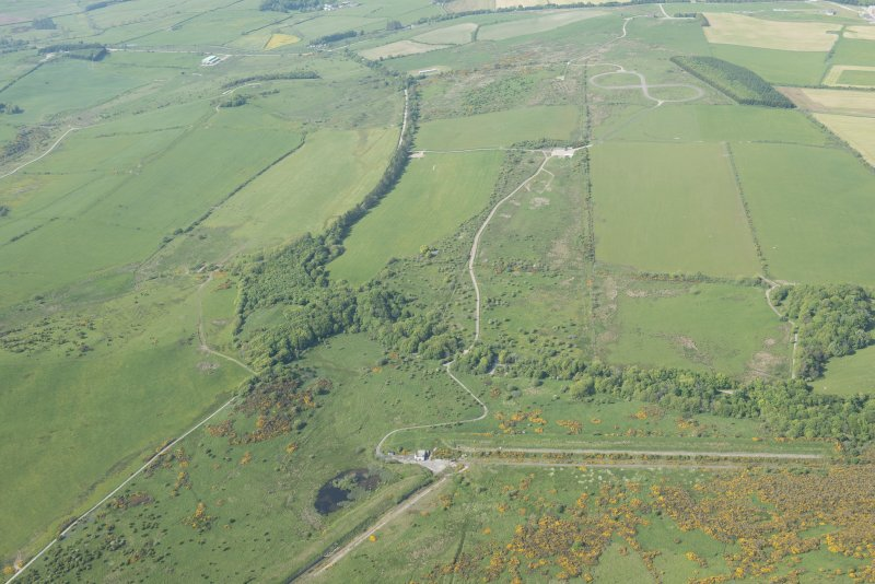 General oblique aerial view of the tracked target and Glennap fort with Chapel Hill in the distance, looking N.
