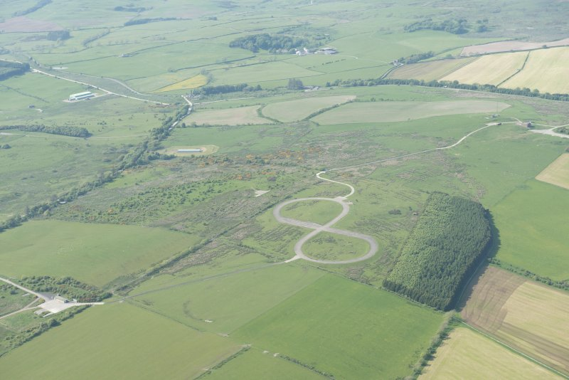 General oblique aerial view of the E part of the Kirkcudbright Training Area centred on the 'figure-of-eight' tracked target at High Barcheskie, looking NNW.