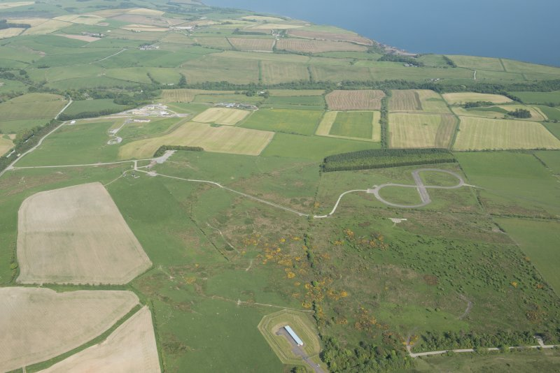 General oblique aerial view of the E part of the Kirkcudbright Training Area centred on the 'figure-of-eight' tracked target at High Barcheskie with Brown Hill and Girdstingwood beyond, looking E.