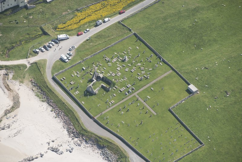 Oblique aerial view of Balnakeil Parish Church and Churchyard, looking to the E.
