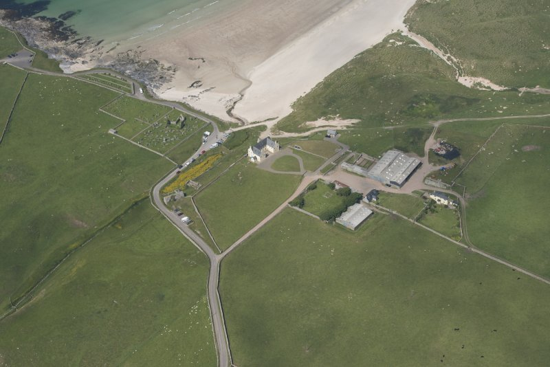 Oblique aerial view of Balnakeil House, Balnakeil Parish Church and Churchyard, looking to the NNW.