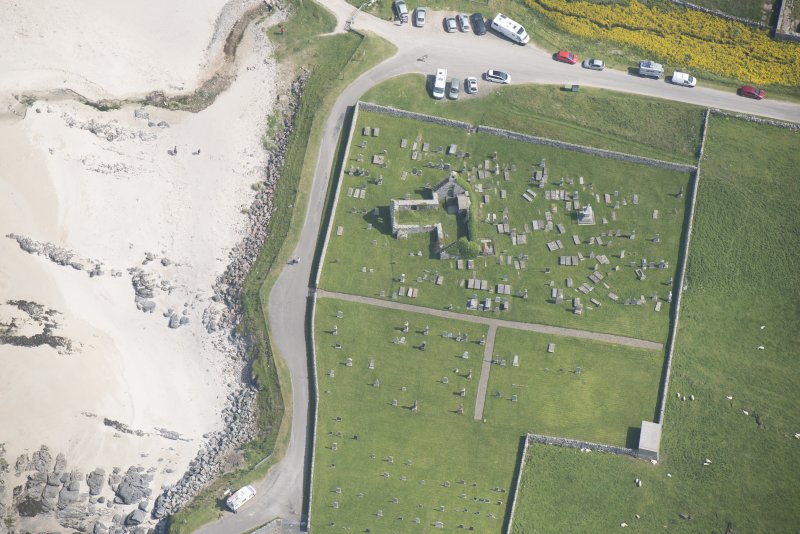 Oblique aerial view of Balnakeil Parish Church and Churchyard, looking to the ESE.