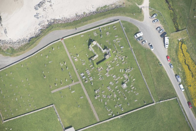 Oblique aerial view of Balnakeil Parish Church and Churchyard, looking to the NE.