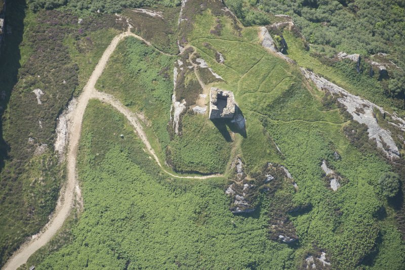Oblique aerial view of Caistal Bharraich tower house, looking to the W.