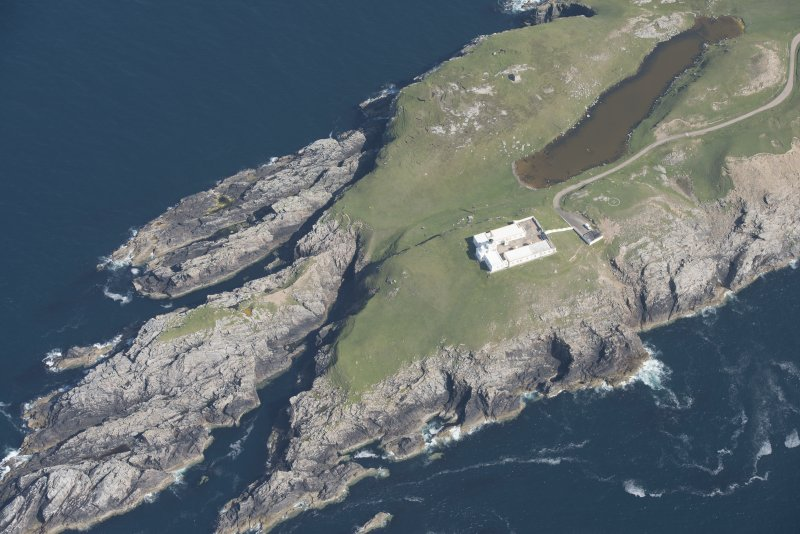 Oblique aerial view of Strathy Point Lighthouse, looking to the NW.