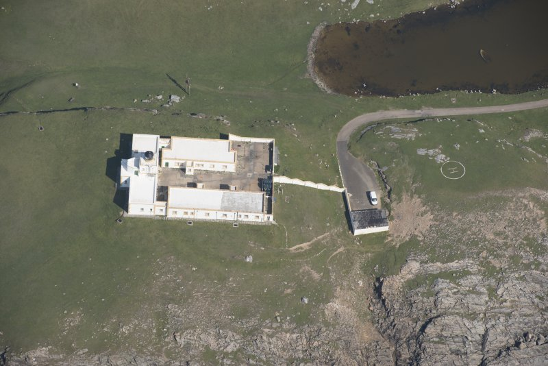 Oblique aerial view of Strathy Point Lighthouse, looking to the E.