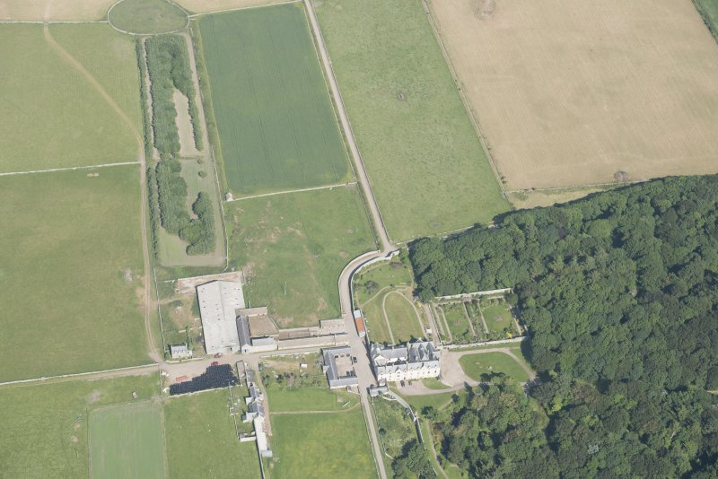 Oblique aerial view of Sandside House, walled garden and Home Farm, looking to the ENE.