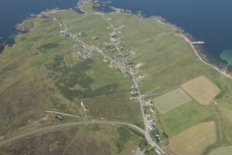 Oblique aerial view of Portskerra and pier, looking to the N.