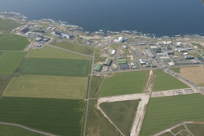 Oblique aerial view of Dounreay, Nuclear Research Facility and airfield, looking to the NW.