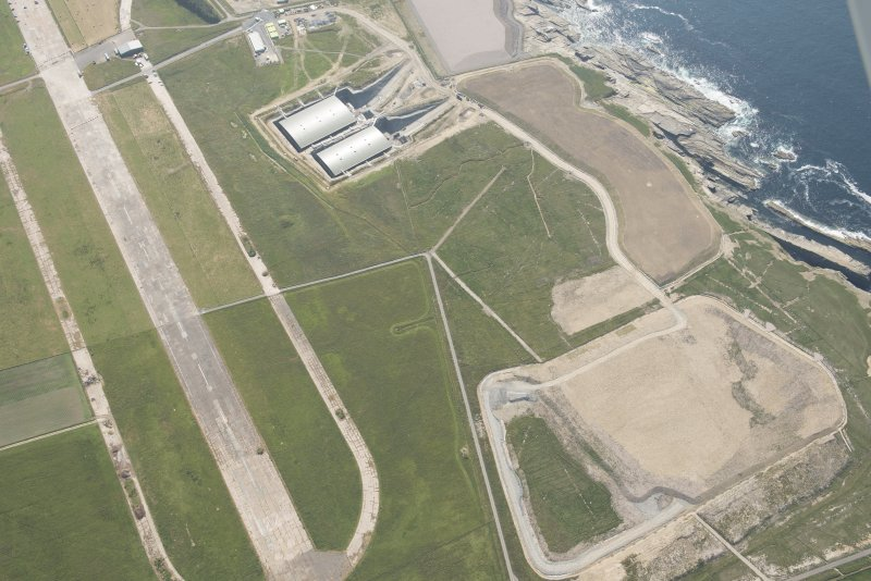 Oblique aerial view of Dounreay Airfield and store houses, looking to the WSW.