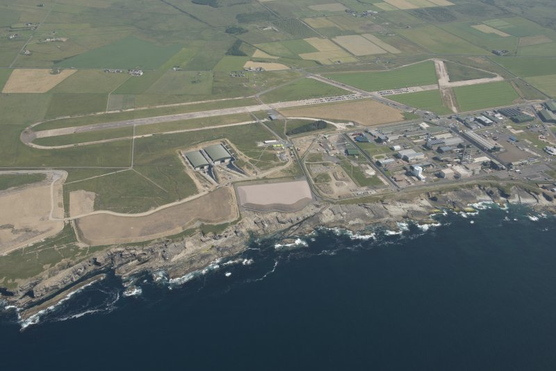Oblique aerial view of Dounreay, Nuclear Research Facility and airfield, looking to the SE.