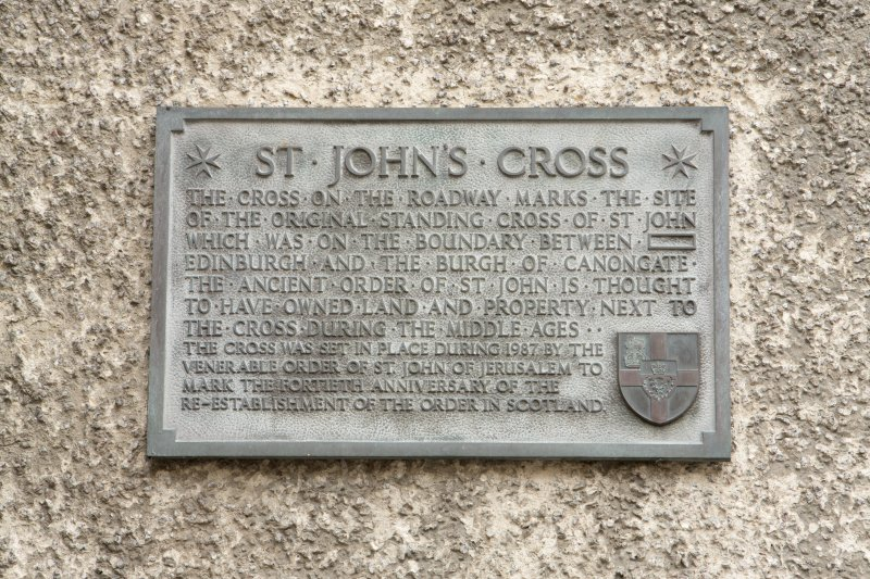 Detail of plaque located on wall of 192 Canongate, Edinburgh, adjacent to site of St John's Cross.