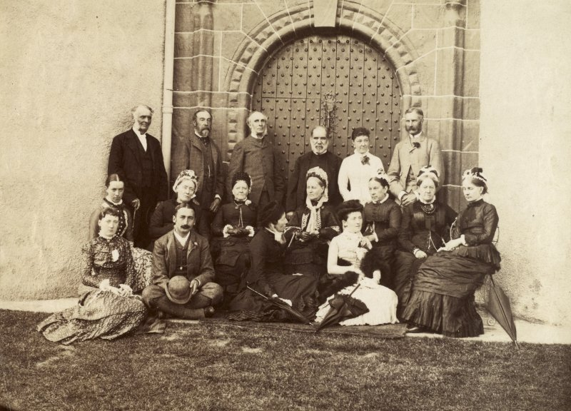 View of family group by gatehouse in Seton Tower, Fyvie Castle. Titled: 'Group at 'Fyvie Castle'. PHOTOGRAPH ALBUM NO 4: INNES OF COWIE ALBUM