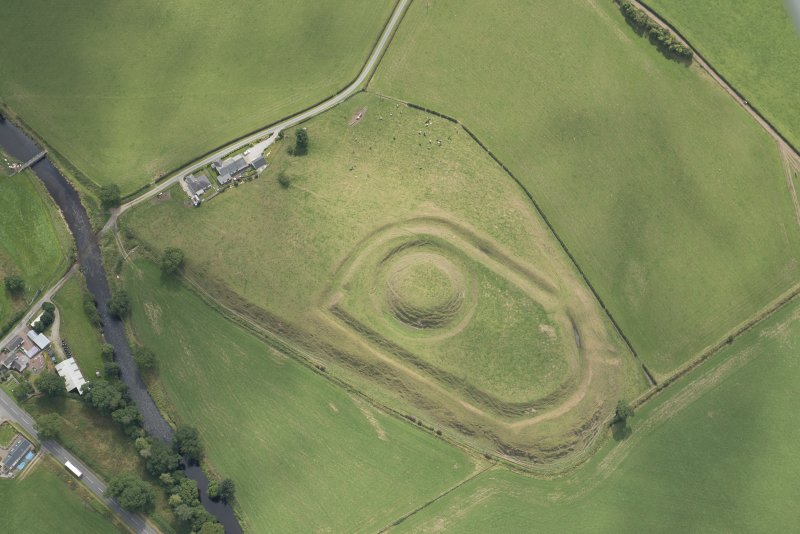 Oblique aerial view of the Mote of Urr, looking SW.