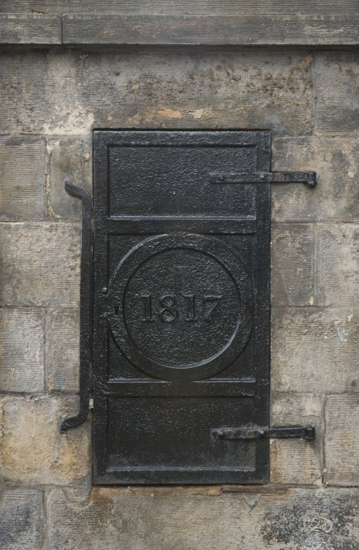 Detail of ironwork including date '1817', on Well, Queensberry House, 64 Canongate, Edinburgh.