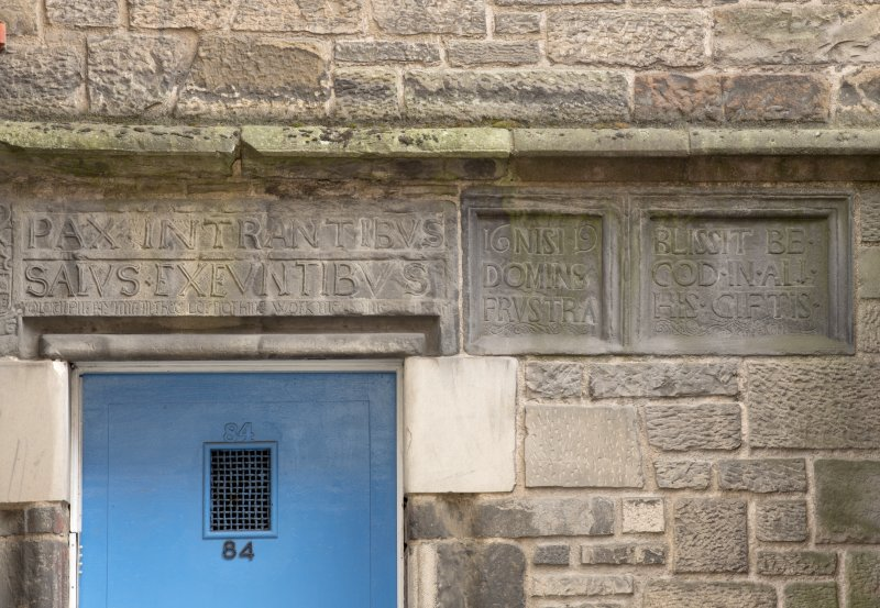Detail of inscribed lintel above entrance to Nisbet of Dirleton's House, 82-84 Canongate, Edinburgh.