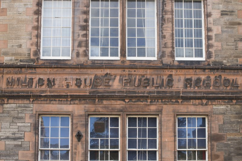 Detail of carved name 'Milton House Public School' at first floor level on front elevation of Milton House School, 86 Canongate, Edinburgh.
