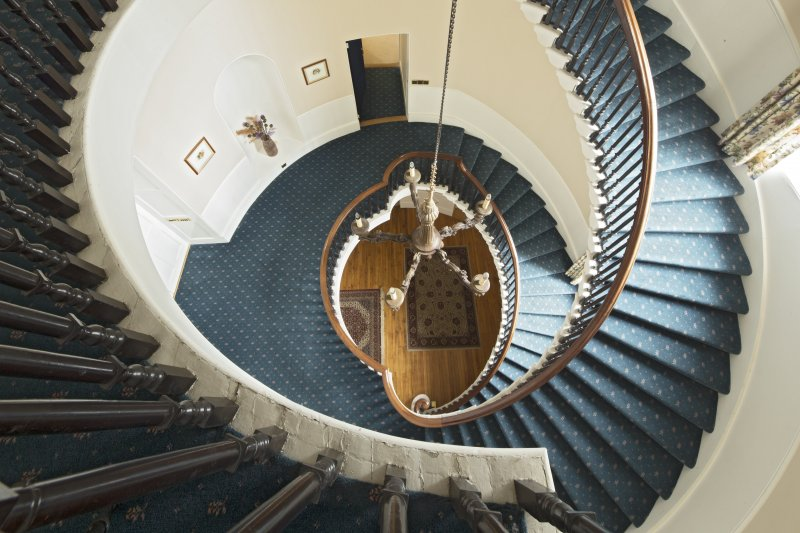 Main staircase looking down from top floor.