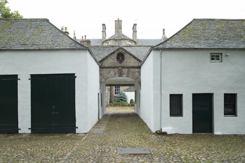 Pend and archway to courtyard from north west.